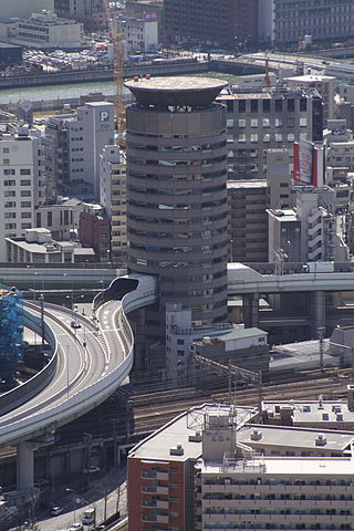 320px-Building_penetrated_by_an_expressway_001_OSAKA_JPN.jpg